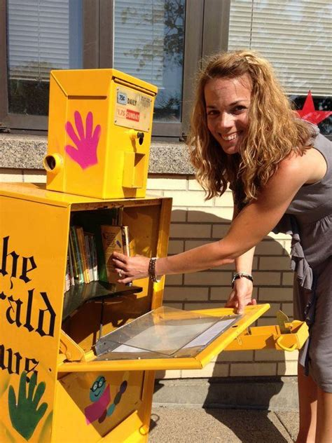 Newspaper boxes repurposed into Little Free Libraries to